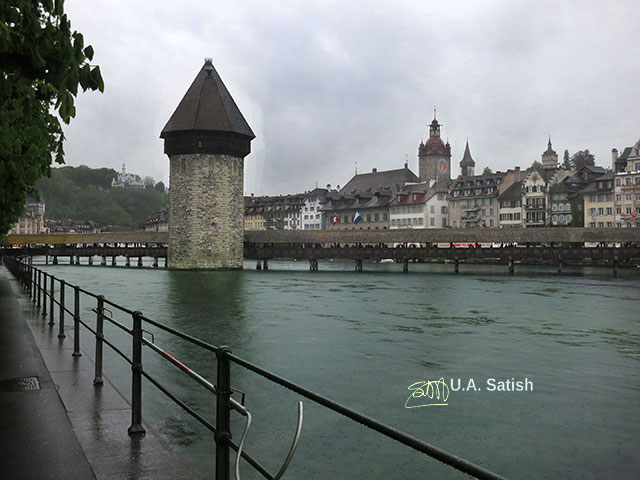 Chapel Bridge; Lucerne; Switzerland; Reuss River; outdoor; travel; clouds; sky; uasatish; buildings;