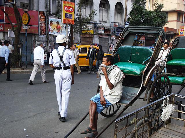 Esplanade; Kolkata; India; outdoor; rickshaw; car; uasatish; policeman; people;