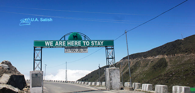 Gangtok-Nathula Road; Sikkim; India; sign; road; sky; white clouds; rocks; uasatish;