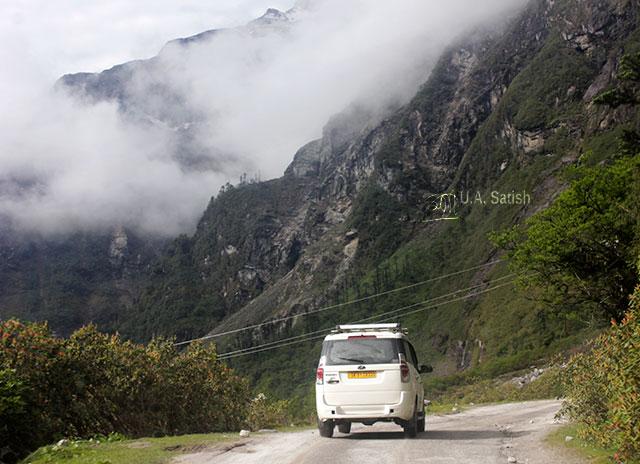 Sikkim; India; road; car; mountain; clouds; uasatish;