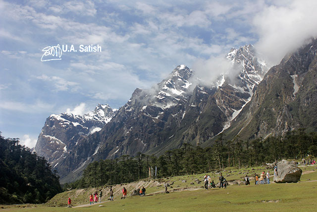 Sikkim; India; Yumthang; valley; mountains; snow; sky; white clouds; meadow; trees; uasatish;