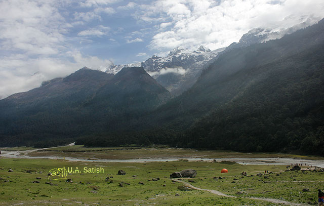 Yumthang; valley; Sikkim; India; stream; mountains; trees; sky; clouds; rocks; uasatish;