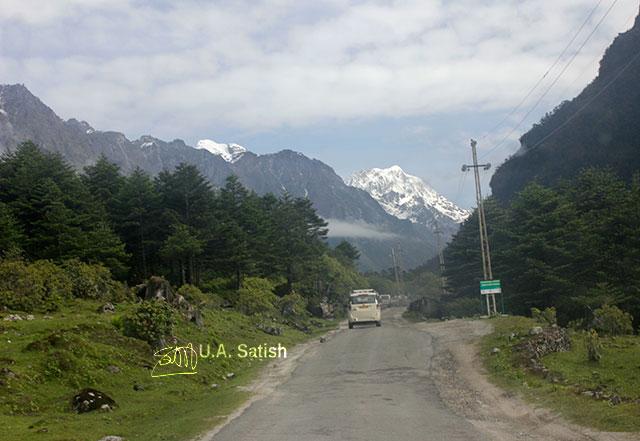 Sikkim; India; road; car; mountain; snow; sky; clouds; trees; uasatish;