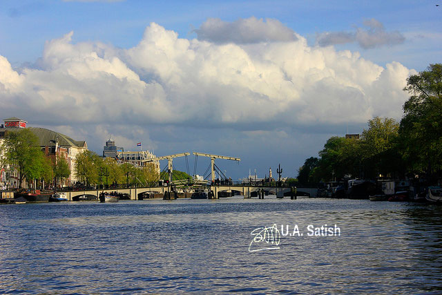 Skinny Bridge; Magere Brug; Amsterdam; Netherlands; canal; sky; clouds; buildings; uasatish;