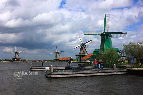 Wooden Windmills; Netherlands; Zaanse Schans; outdoors; water; sky; uasatish; https://uasatish.com; Zaandam;