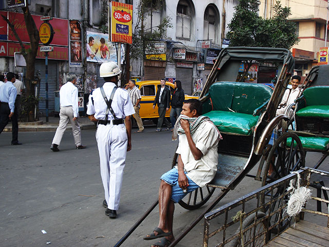 Esplanade; Kolkata; India; outdoor; rickshaw; car; uasatish; policeman; people;