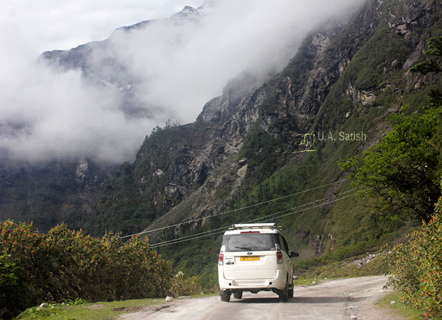 Sikkim; India; road; car; mountain; clouds; uasatish;