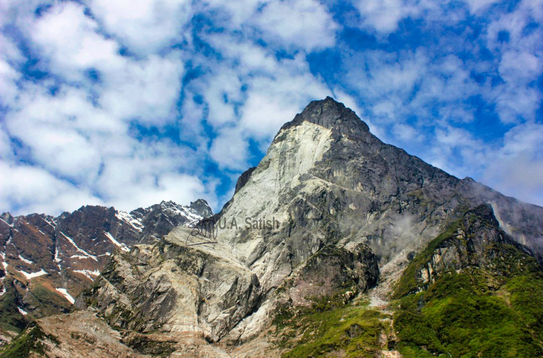 Sheared Mountain Face; Sikkim; uasatish; sky; clouds;
