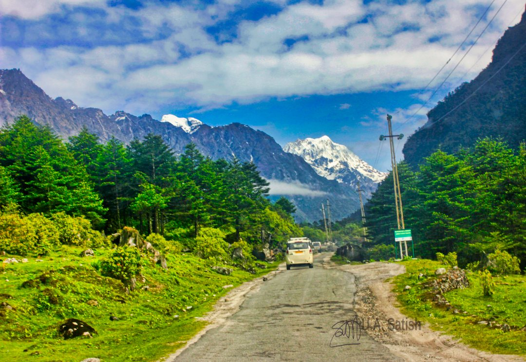 Sikkim; mountains; snow; sky; clouds; trees; road; car; uasatish;