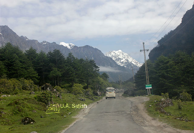 Sikkim; India; road; car; mountain; snow; sky; clouds; trees; uasatish;