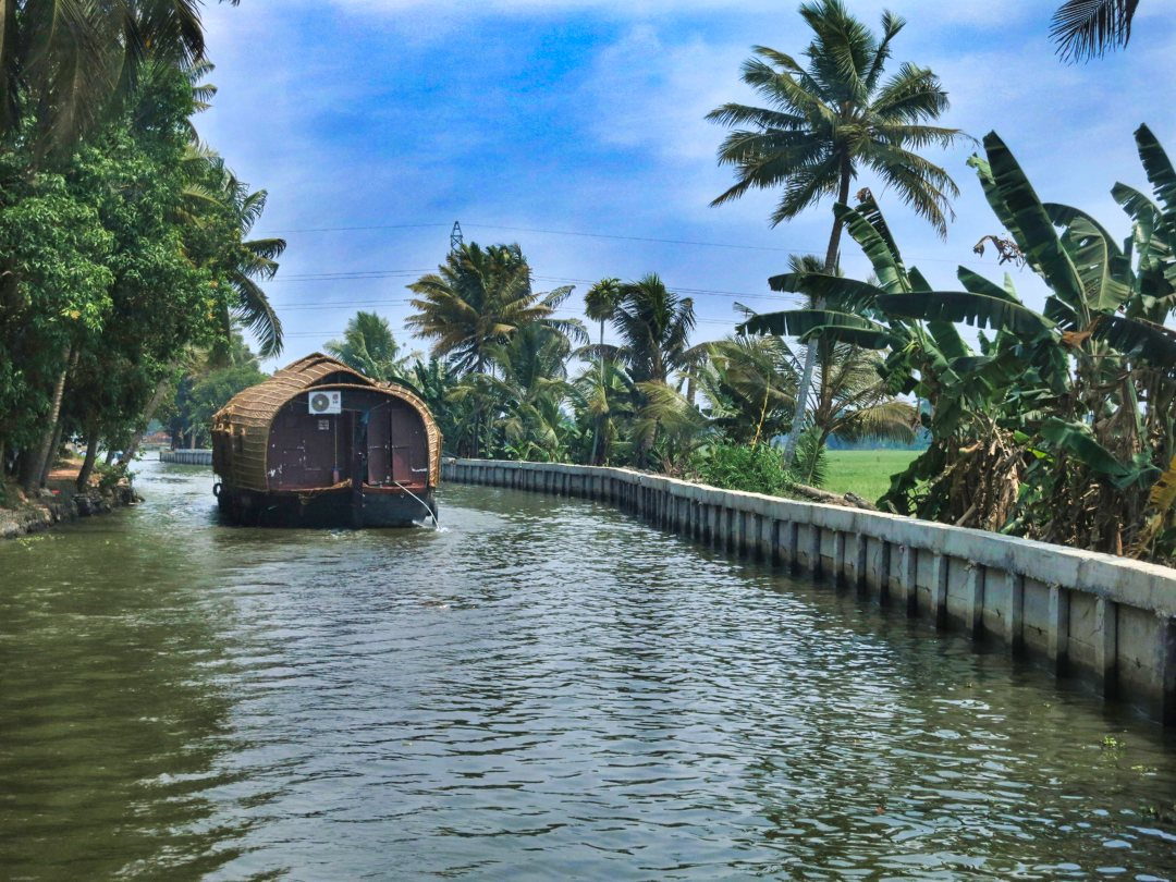 Alleppey Canal; houseboat; Kerala; sky; white clouds; trees; uasatish; Save Money While You Travel;