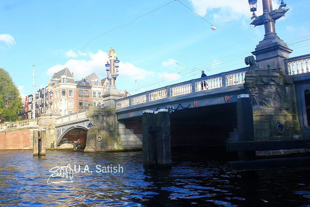 Blauwbrug (Blue Bridge); Amsterdam; canal; water; bridge; sky; clouds; uasatish;