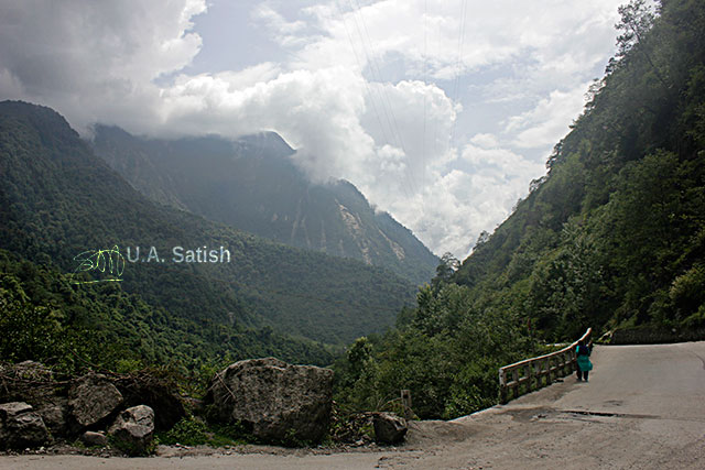 Sikkim; India; North Sikkim; road; mountains; bridge; clouds; rocks; sky; uasatish;
