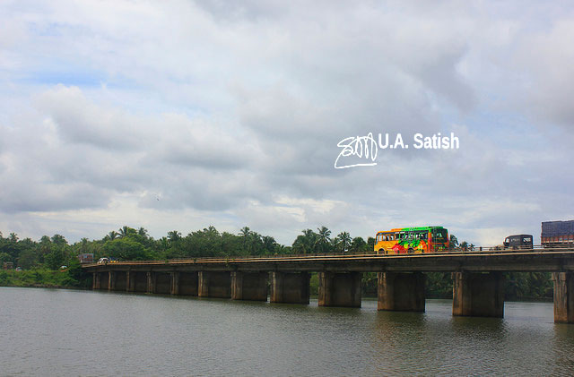 Kariyankode Bridge; Cheruvathur; Kerala; India; river; clouds; sky; uasatish; bus;
