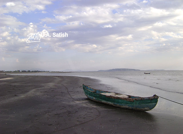 Rangaon Beach; Vasai; beach; India; boat; sand; sky; clouds; uasatish;