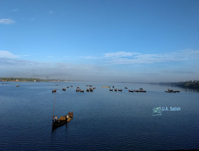train travel; Kerala; Kannur to Kanhangad; North Malabar; uasatish; India; Valapattanam River; boats; sand mining;