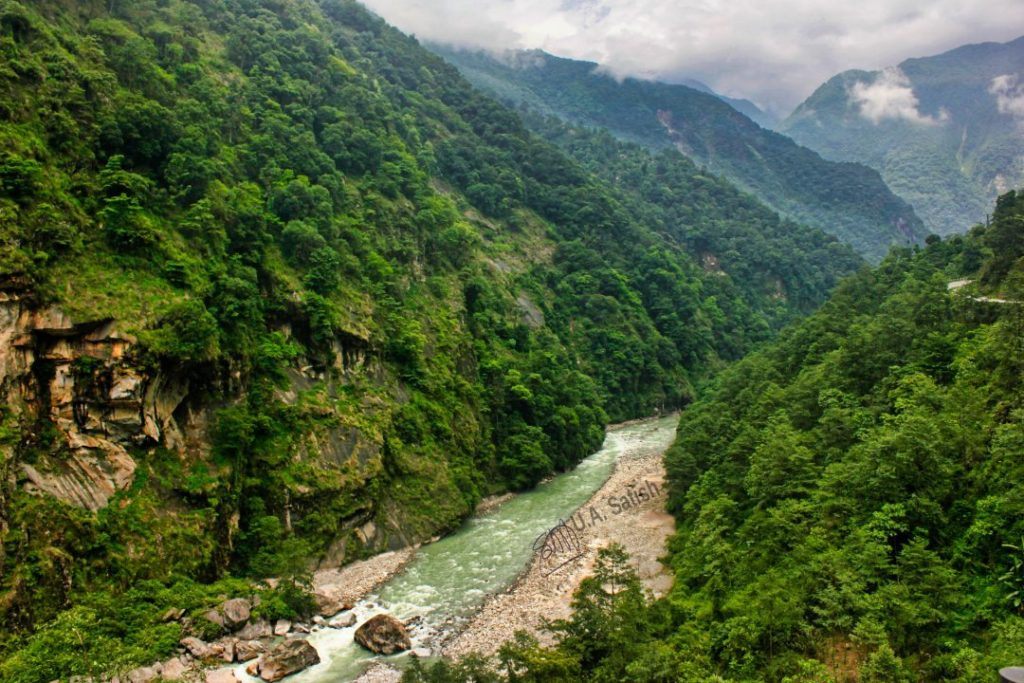 River Teesta; Sikkim; uasatish; mountains; clouds; trees;