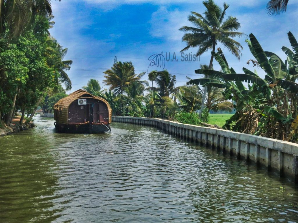 Passing Through a Canal; Kerala God's Own Country; houseboat; sky; clouds; usatish; Alappuzha Houseboat Cruise;